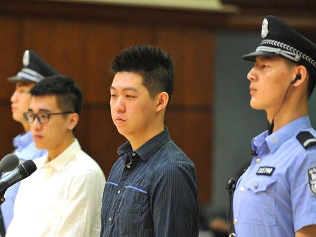 Tang-Weitian-and-Yu-Muchun-standing-on-trial-in-a-court-room-in-Beijing-AFP-Photo-Chaoyang-District-People-s-Court