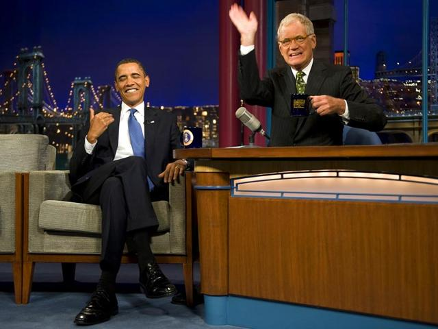 This-September-21-2009-file-photo-shows-US-President-Barack-Obama-L-joking-with-David-Letterman-in-an-episode-of-the-Late-Show-with-David-Letterman-in-New-York-City-The-king-of-late-night-television-David-Letterman-brought-the-curtain-down-on-a-33-year-long-career-in-an-emotional-final-show-May-20-2015-packed-with-jokes-and-farewells-from-US-presidents-Hollywood-stars-and-devoted-fans-The-last-ever-Late-Show-with-David-Letterman-brings-to-an-end-an-American-cultural-institution-that-has-been-watched-by-millions-and-an-extraordinary-career-that-has-inspired-a-generation-of-comedians-AFP-PHOTO-Files