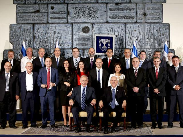 Members-of-the-newly-sworn-in-government-of-Israel-pose-for-a-group-photo-in-Jerusalem-AFP-photo