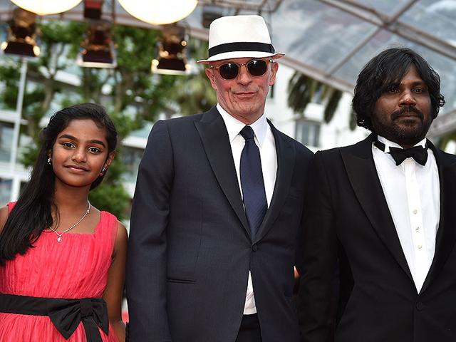 From-L-Sri-Lankan-actor-Claudine-Vinasithamby-French-director-Jacques-Audiard-and-Sri-Lankan-actor-Jesuthasan-Antonythasan-pose-as-they-arrive-for-the-screening-of-the-film-Dheepan-at-the-68th-Cannes-Film-Festival-in-Cannes-southeastern-France-on-May-21-2015-AFP