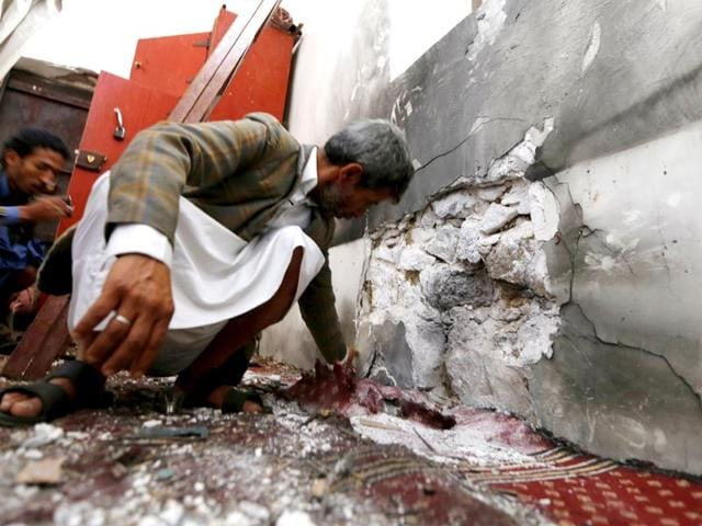 People-inspect-damage-caused-by-a-bomb-explosion-at-a-mosque-in-Yemen-s-capital-Sanaa-May-22-2015-The-Islamic-State-claimed-responsibility-for-the-attack-in-a-statement-on-Twitter-REUTERS