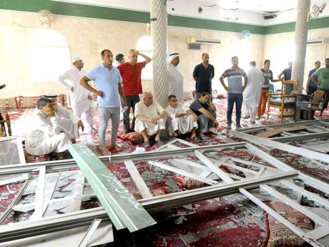 Men-gather-around-debris-following-a-blast-inside-a-mosque-in-Qatif-Saudi-Arabia-A-suicide-bomber-targeted-a-Shiite-mosque-during-Friday-prayers-in-Kudeih-the-interior-ministry-said-with-activists-saying-at-least-four-worshippers-were-killed-AFP-Photo