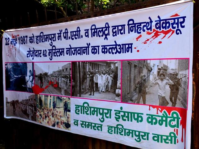 A-poster-on-a-wall-in-Hashimpura-Merrut-UP-The-state-govt-has-moved-the-Delhi-HC-challenging-the-acquittal-of-16-PAC-members-in-an-alleged-masscare-28-years-ago-Chahatram-HT-Photo
