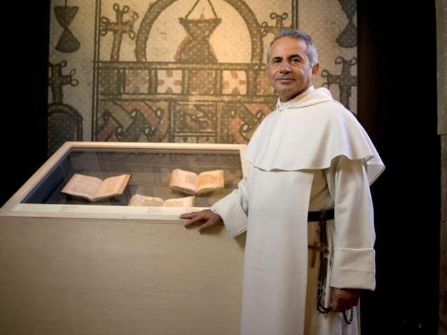 Iraqi-friar-Najeeb-Michaeel-of-the-Roman-Catholic-Dominican-Order-in-Paris-Michaeel-saved-hundreds-of-ancient-Christian-manuscripts-dated-between-the-13th-and-19th-century-from-IS-took-them-to-Kurdistan-AFP-Photo