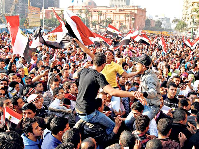 Egyptians-in-Cairo-s-Tahrir-Square-on-February-12-2011-celebrate-the-fall-of-Hosni-Mubarak-MOHAMMED-ABED-AFP-Photo