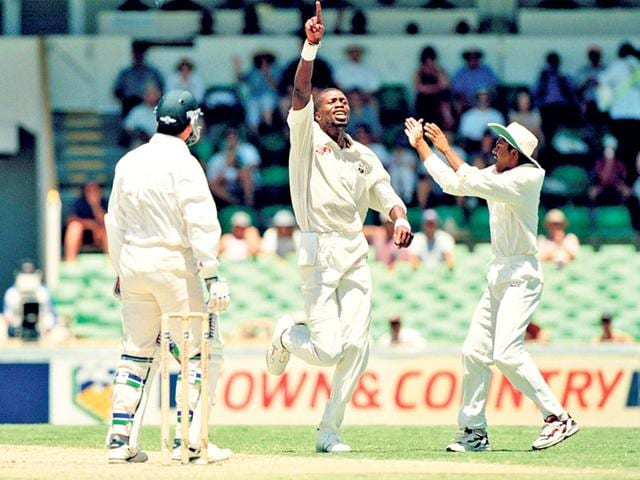 Ambrose-celebrates-the-wicket-of-Australia-batsman-Steve-Waugh-during-the-5th-Test-match-held-at-Perth-on-1st-February-1997-West-Indies-won-by-10-wickets-DAVID-MUNDEN-POPPERFOTO-GETTY-IMAGES