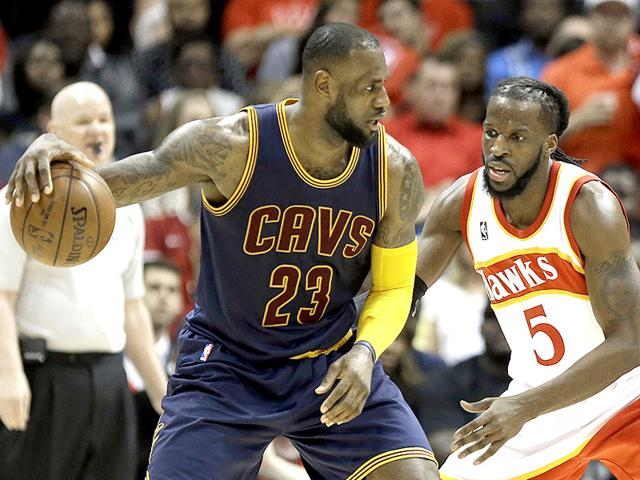 Cleveland-Cavaliers-forward-LeBron-James-drives-near-Atlanta-Hawks-forward-DeMarre-Carroll-during-the-first-half-in-Game-2-of-the-Eastern-Conference-finals-of-the-NBA-basketball-playoffs-in-Atlanta-AP-Photo