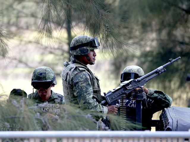 Mexican-Army-soldiers-stand-guard-near-the-entrance-of-Rancho-del-Sol-AP-Photo