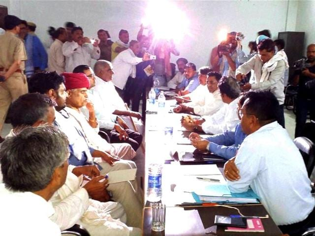 Gujjar-leader-Kirori-Singh-Bainsla-talks-with-Rajasthan-cabinet-ministers-at-a-meeting-to-demand-reservation-in-government-jobs-and-educational-institutions-for-the-community-near-Bayana-village-in-Bharatpur-district-of-Rajasthan-on-Saturday-PTI-Photo