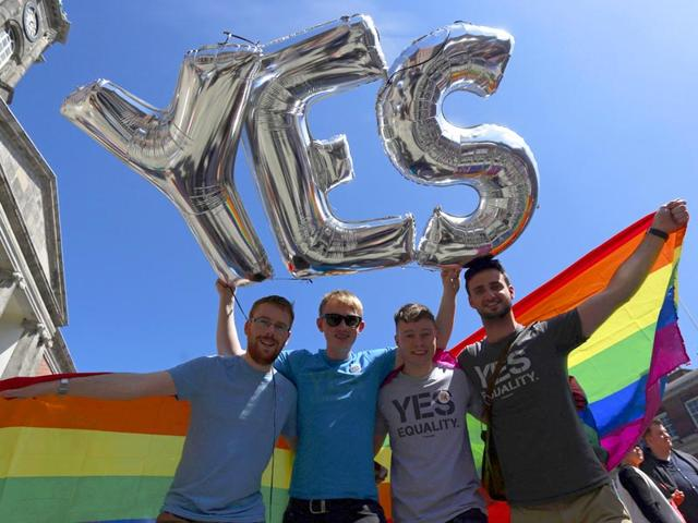 Men-walk-past-a-Yes-vote-campaign-graffiti-in-central-Dublin-as-Ireland-holds-a-referendum-on-gay-marriage-May-22-2015-REUTERS