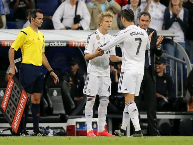 Cristiano-Ronaldo-embraces-16-year-old-Martin-Odegaard-from-Norway-as-he-leaves-the-field-during-a-Spanish-La-Liga-soccer-match-between-Real-Madrid-and-Getafe-at-the-Santiago-Bernabeu-stadium-AP-Photo