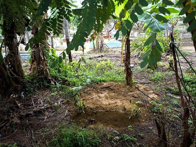 In-this-picture-taken-on-May-23-2015-the-unmarked-grave-C-of-Shahira-Bibi-a-three-year-old-Rohingya-girl-from-Myanmar-is-seen-at-a-public-cemetery-near-the-hospital-of-Langsa-in-Aceh-province-AFP-Photo