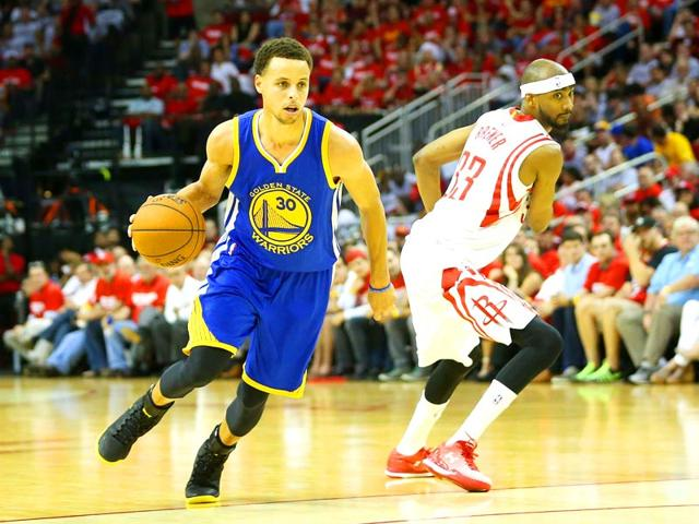 Stephen-Curry-of-the-Golden-State-Warriors-drives-against-Corey-Brewer-of-the-Houston-Rockets-in-the-third-quarter-during-Game-Three-of-the-Western-Conference-Finals-of-the-2015-NBA-PLayoffs-at-Toyota-Center-in-Houston-Texas-AFP-Photo