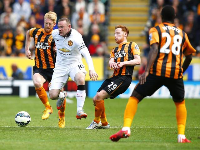 Hull-City-s-Paul-McShane-and-Stephen-Quinn-in-action-against-Manchester-United-s-Wayne-Rooney-in-their-English-Premier-League-EPL-match-at-Kingston-Communications-Stadium-on-May-24-2015-Reuters-Photo