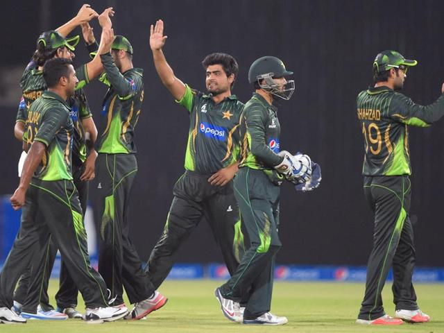 Pakistan-cricketers-celebrate-after-taking-the-wicket-of-a-Zimbabwe-batsman-during-the-second-and-final-T20I-cricket-match-between-Pakistan-and-Zimbabwe-at-Gaddafi-Cricket-Stadium-in-Lahore-on-May-24-2015-AFP-Photo