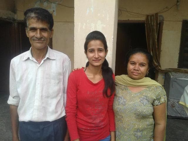 CBSE-topper-priya-mehta-with-her-parents-HT-photo