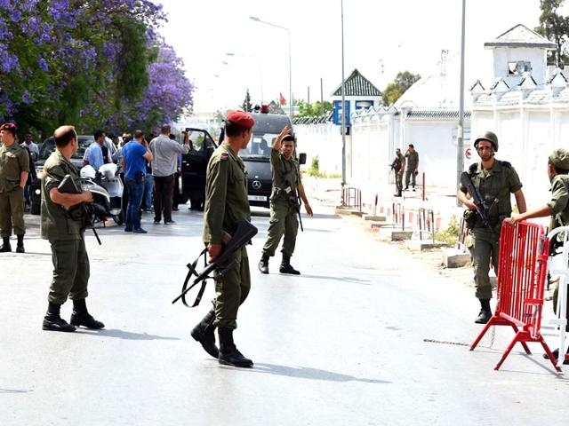 Tunisian-anti-terrorism-brigade-officers-lead-their-dogs-after-a-shooting-at-the-Bouchoucha-military-base-in-Tunis-Reuters-Photo