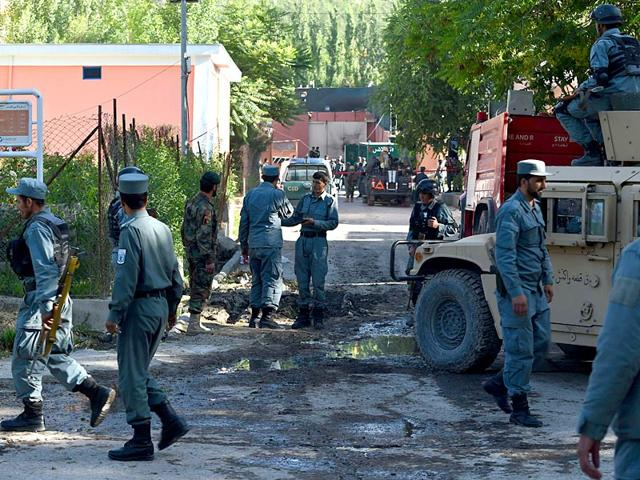 Afghan-security-forces-gather-outside-the-gate-of-the-Heetal-Hotel-in-Kabul-on-May-27-2015-All-four-attackers-were-killed-after-security-forces-waged-an-all-night-battle-with-Taliban-militants-who-tried-to-storm-a-guesthouse-AFP-Photo