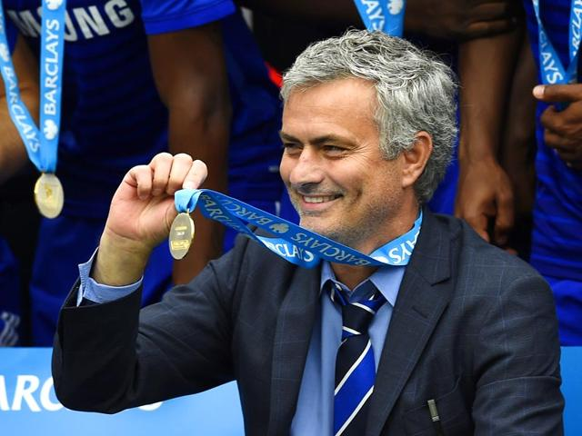 Chelsea-manager-Jose-Mourinho-holds-up-his-medal-after-winning-the-Barclays-Premier-League-Reuters