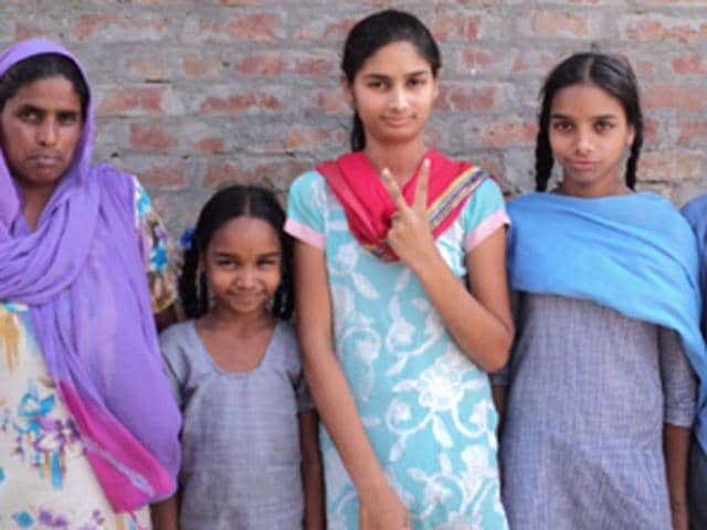 Asha-Rani-23rd-position-celerates-her-achievement-with-her-family-at-Bhaini-Salu-village-in-Ludhiana-on-Tuesday-HT-photo