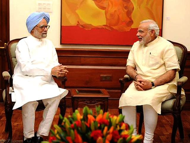 Former-PM-Manmohan-Singh-with-Prime-Minister-Narendra-Modi-at-his-official-residence-at-7-RCR-in-New-Delhi-Photo-Courtesy-PMOIndia