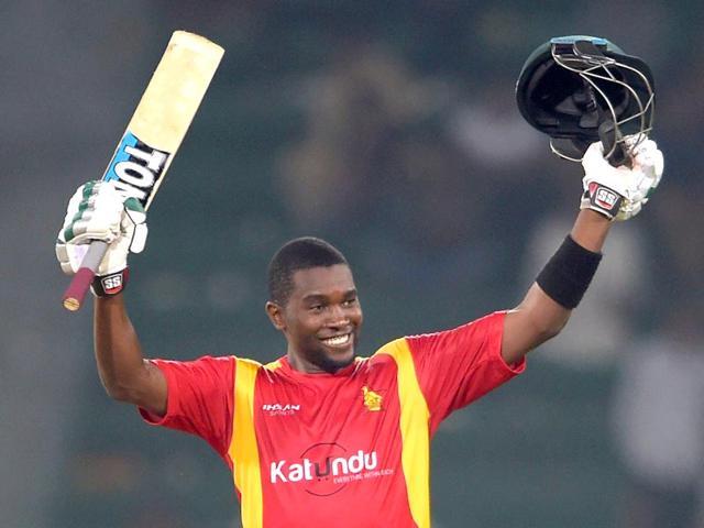 Zimbabwe-s-captain-Elton-Chigumbura-celebrates-after-scoring-a-century-during-the-first-one-day-international-match-between-Pakistan-and-Zimbabwe-at-the-Gaddafi-Cricket-Stadium-in-Lahore-AFP-PHOTO