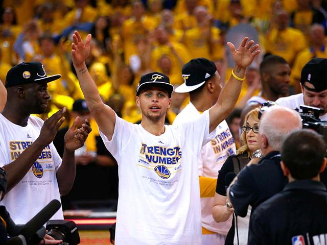 Stephen-Curry-of-the-Golden-State-Warriors-celebrates-the-Warriors-104-90-victory-against-the-Houston-Rockets-during-game-five-of-the-Western-Conference-Finals-of-the-2015-NBA-Playoffs-at-ORACLE-Arena-in-Oakland-California-AFP-Photo