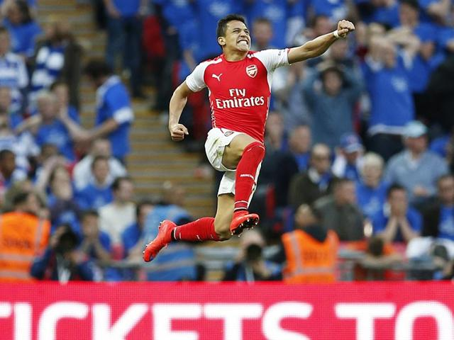 Alexis-Sanchez-celebrates-after-scoring-the-second-goal-for-Arsenal-in-the-FA-Cup-Semi-Final-against-Reading-at-the-Wembley-Stadium-in-London-Reuters