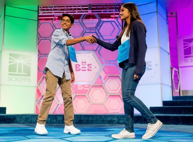 Vanya-Shivashankar-right-13-of-Olathe-and-Gokul-Venkatachalam-14-of-St-Louis-shake-hands-as-co-champions-after-winning-the-finals-of-the-Scripps-National-Spelling-Bee-in-Oxon-Hill-AP-Photo