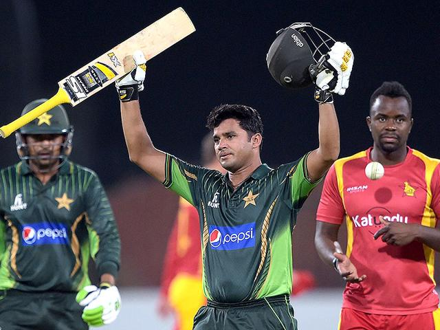 Pakistan-s-captain-Azhar-Ali-C-celebrates-after-scoring-a-century-100-runs-as-teammate-Haris-Sohail-L-and-Zimbabwe-bowler-Brian-Vitori-R-look-on-during-the-second-One-Day-International-ODI-cricket-match-between-Pakistan-and-Zimbabwe-at-the-Gaddafi-Cricket-Stadium-AFP-Photo