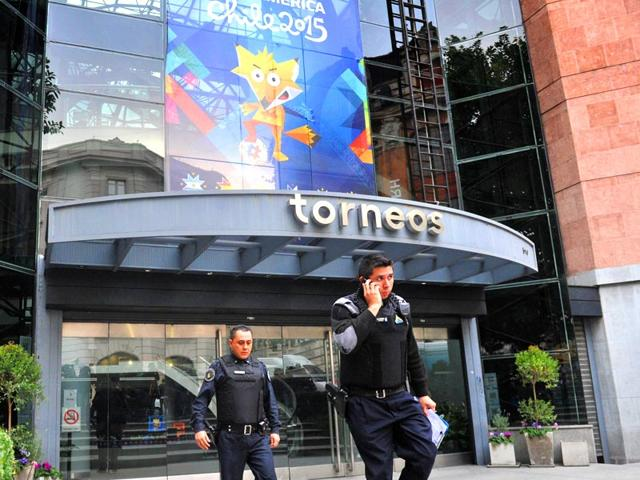 Members-of-Interpol-are-seen-at-the-headquarters-of-Argentine-sports-broadcaster-Torneos-y-Competencias-Torneos-during-a-raid-in-Buenos-Aires-AFP-Photo