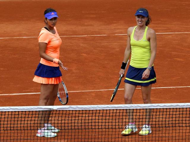 Martina-Hingis-of-Switzerland-right-and-Sania-Mirza-of-India-talk-while-playing-Stephanie-Foretz-and-Amandine-Hesse-of-France-during-their-second-round-women-s-doubles-match-of-the-French-Open-at-Roland-Garros-in-Paris-PTI-Photo