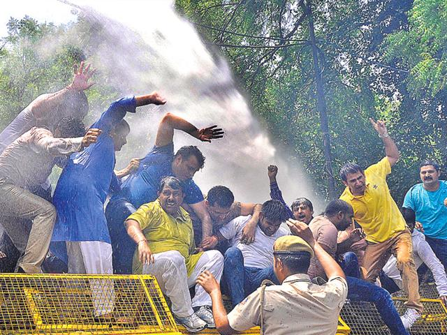 BJP-workers-try-to-breach-barricades-during-a-protest-outside-chief-minister-Arvind-Kejriwal-s-residence-on-Saturday-Sonu-Mehta-HT-Photo