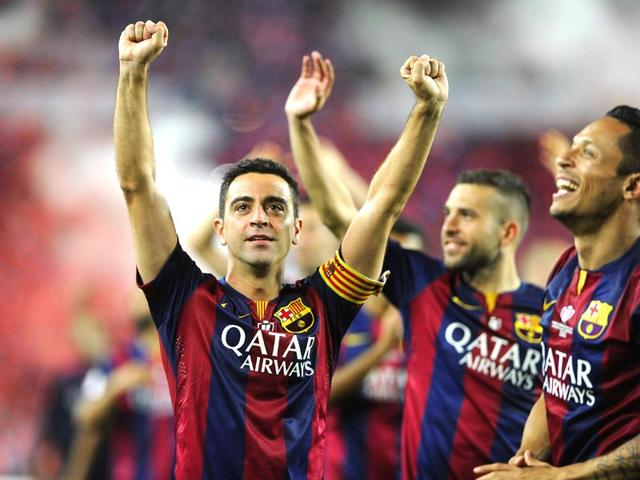 Barcelona-midfielders-Xavi-Hernandez-R-and-Andres-Iniesta-L-celebrate-with-the-trophy-after-beating-Athletic-Bilbao-in-the-Spanish-Copa-del-Rey-King-s-Cup-final-at-Camp-Nou-in-Barcelona-on-May-30-2015-AFP-Photo