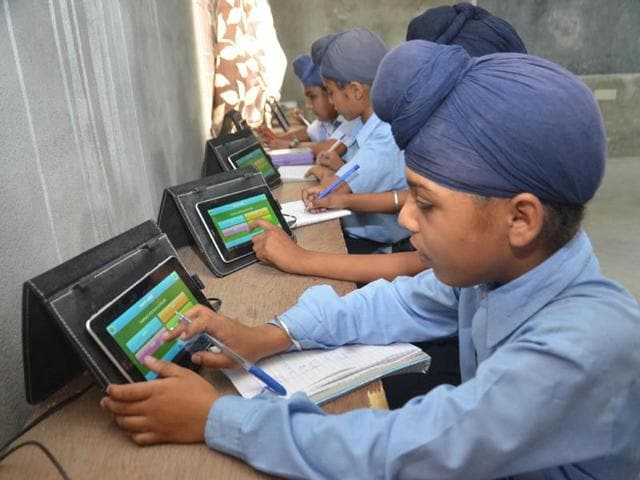 Students-of-Sikh-Heritage-Model-School-at-Harchowal-village-in-Gurdaspur-using-tablets-to-solve-mathematical-problems-in-their-classroom-Sameer-Sehgal-HT