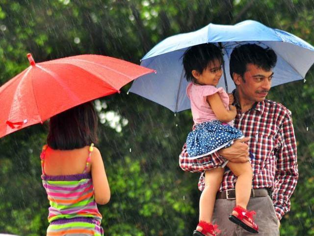 People-enjoying-rain-at-Sukhna-lake-in-Chandigarh-Karun-Sharma-HT