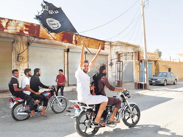 Immortan-Joe-s-soldiers-are-hooded-men-violent-senseless-men-They-are-a-suicide-squad-lured-by-the-promise-of-an-illuminated-paradise-the-colour-of-chrome-They-are-familiar-because-they-resemble-ISIS-Reuters-Photo