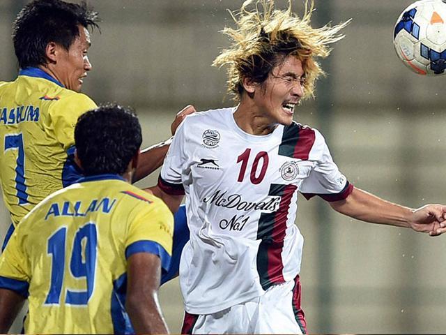 Katsumi-Yusa-of-Mohun-Bagan-white-vie-for-the-ball-during-an-I-League-2014-15-match-against-Mumbai-FC-PTI-Photo-Shashank-Parade