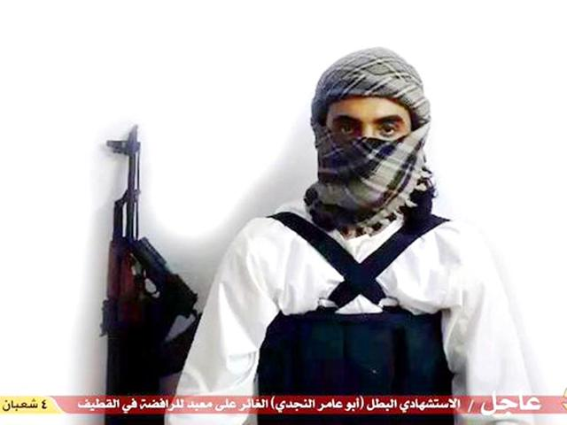 File-image-taken-from-a-militant-website-associated-with-IS-extremists-purports-to-show-a-suicide-bomber-with-the-Arabic-bar-below-reading-Urgent-The-heroic-martyr-Abu-Amer-al-Najdi-the-attacker-of-the-Shiite-temple-in-Qatif-which-the-IS-group-s-radio-station-claimed-responsibility-for-Militant-photo-via-AP