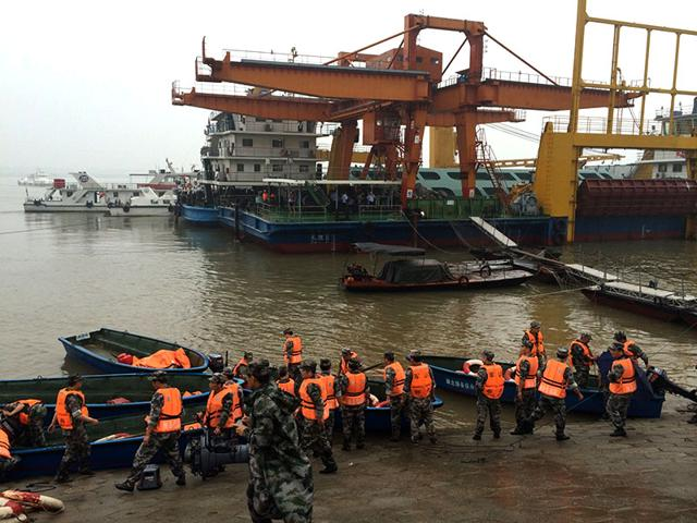 Chinese-rescue-boats-are-seen-alongside-a-capsized-passenger-ship-carrying-more-than-450-people-which-sunk-in-the-Yangtze-river-AFP-photo