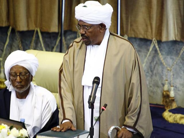 Sudanese-President-Omar-al-Bashir--puts-his-hand-on-a-copy-of-the-Koran-Islam-s-holy-book-during-his-swearing-in-ceremony-for-another-term-of-five-years-at-the-parliament-in-Khartoum-AFP-Photo