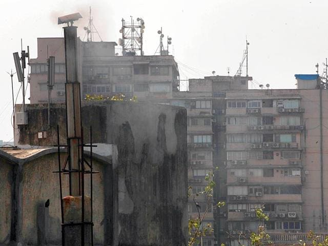 The-residents-of-the-building-opposite-the-Fernandes-bakery-at-Bhalero-Marg-in-Gaiwadi-said-the-bakery-s-chimney-has-been-releasing-black-smoke-five-times-a-day-for-the-past-three-years-Anshuman-Poyrekar-HT-photo