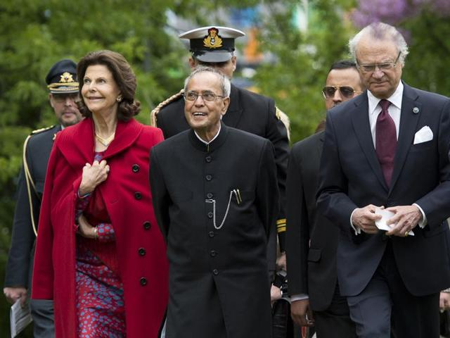 Queen-Silvia-of-Sweden-left-President-Pranab-Mukherjee-and-King-Carl-Gustaf-of-Sweden-walk-outside-the-Nobel-Forum-at-Karolinska-Institute-on-Tuesday-in-Stockholm-on-the-third-and-last-day-of-Mukherjee-s-official-visit-to-the-country-AFP-PHOTO