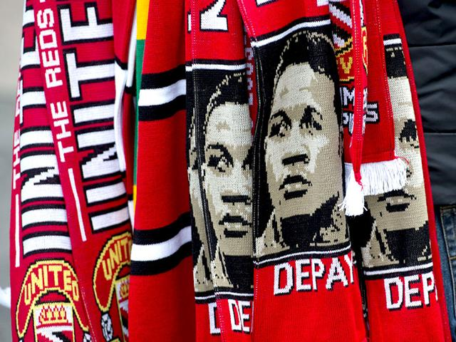 A-vendor-sells-scarves-featuring-the-image-of-Memphis-Depay-outside-Old-Trafford-AFP-PHOTO