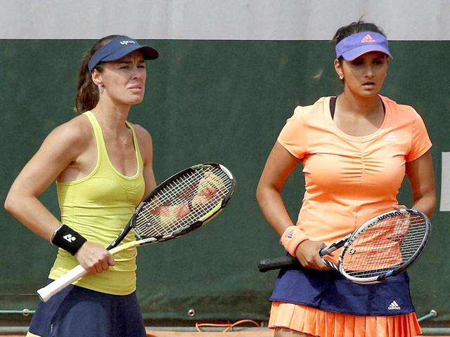 Martina-Hingis-of-Switzerland-left-and-Sania-Mirza-of-India-talk-while-playing-Stephanie-Foretz-and-Amandine-Hesse-of-France-during-their-second-round-match-of-the-French-Open-in-Paris-The-Indo-Swiss-pair-on-June-24-2015-reached-the-semi-finals-of-the-Aegon-International-grass-court-tournament-in-Eastbourne-England-PTI-Photo