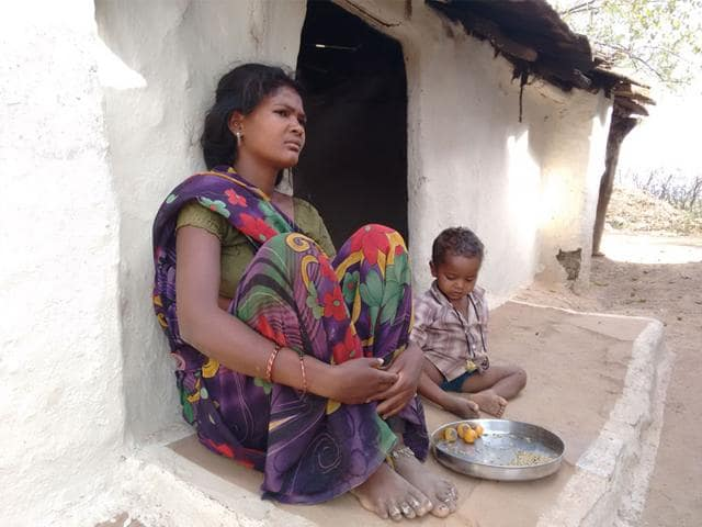 A-woman-with-her-son-at-Naya-Balarpur-village-in-Shivpuri-district-whose-husband-works-at-a-stone-mine-M-Poornima-HT-photo