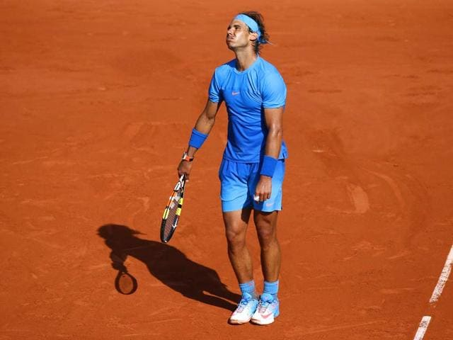 Spain-s-Rafael-Nadal-reacts-after-a-point-against-Serbia-s-Novak-Djokovic-during-their-men-s-quarterfinal-match-of-the-2015-French-Open-in-Paris-France-AFP-Photo