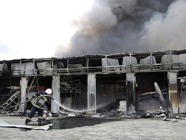 A-firefighter-works-to-extinguish-a-fire-at-a-local-market-which-was-damaged-by-shelling-in-Donetsk-Ukraine-Reuters-Photo
