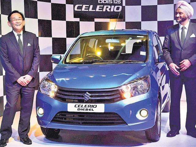 Maruti-Suzuki-MD-and-CEO-Kenichi-Ayukawa-left-with-executive-director-marketing-and-sales-RS-Kalsi-during-the-launch-of-Celerio-Diesel-in-New-Delhi-on-Wednesday-PTI-Photo