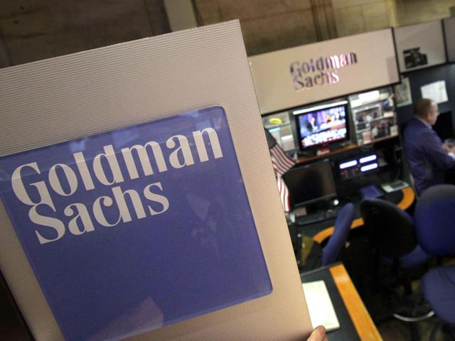 A-trader-works-in-the-Goldman-Sachs-booth-on-the-floor-of-the-New-York-Stock-Exchange-AP-Photo